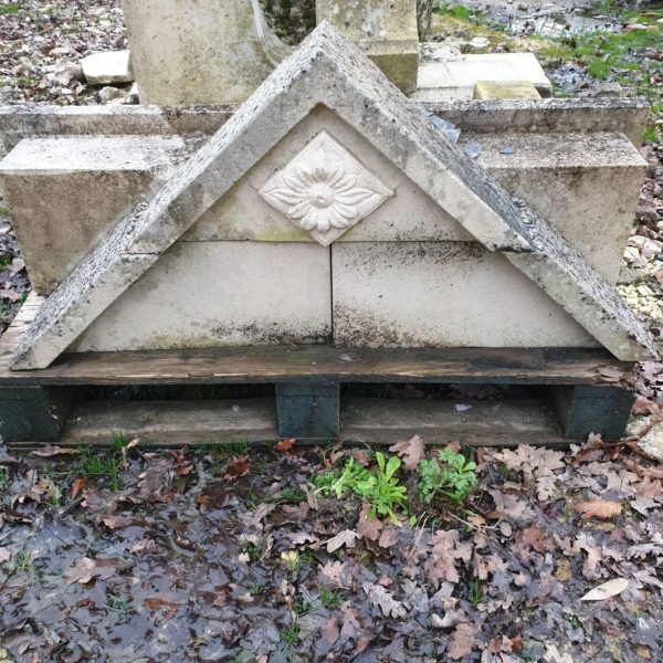 dormer with triangular pediment carved with a small hard stone flower