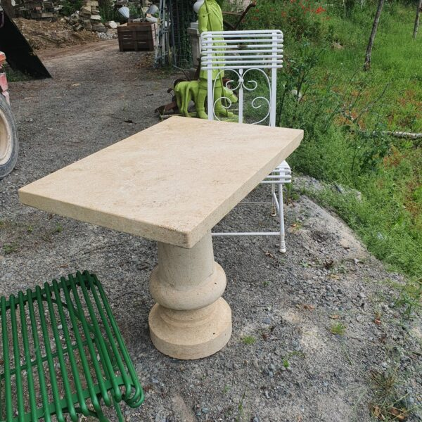 Old garden table in natural stone