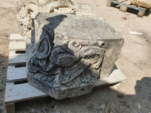 old capital in natural stone