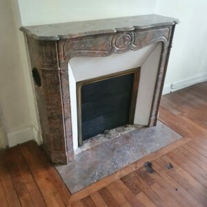 Old fireplace in red marble